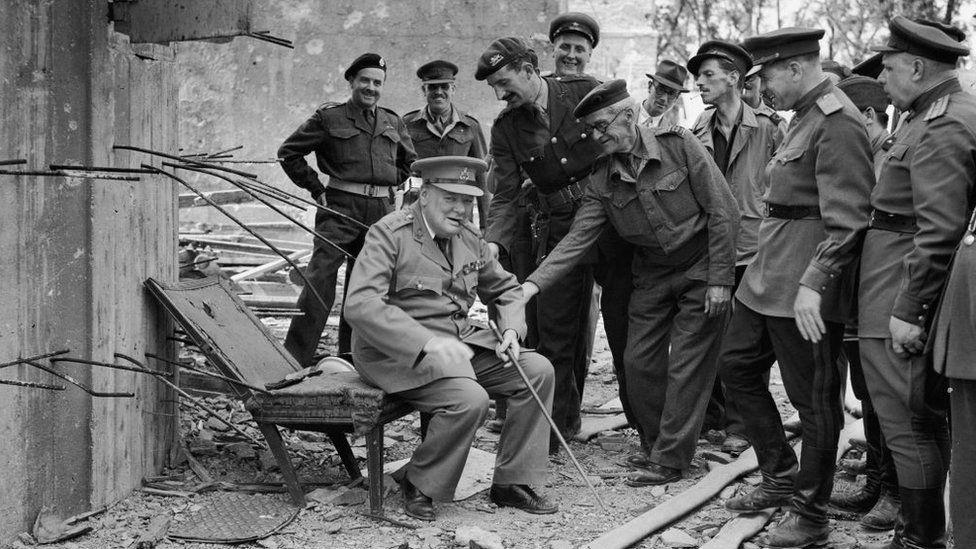 Winston Churchill sitting on a chair outside Hitler's bunker 1945
