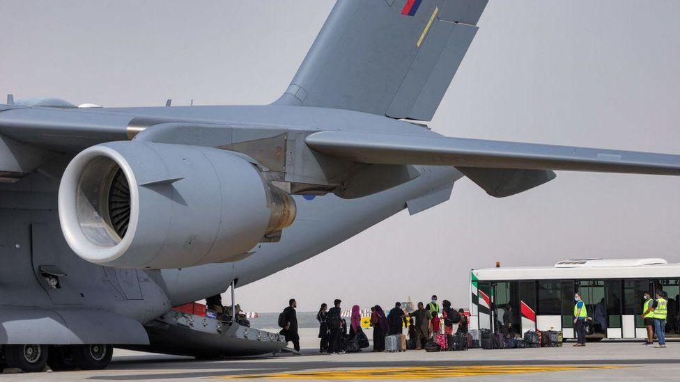 Afghans disembark a C-17 in the UAE
