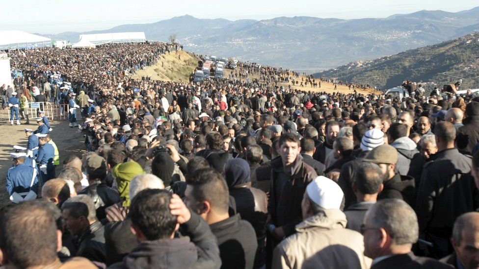 Relatives and people attend the funeral of Hocine Ait Ahmed, the Algerian leader of the Front of Socialist Forces party (FFS), at his hometown