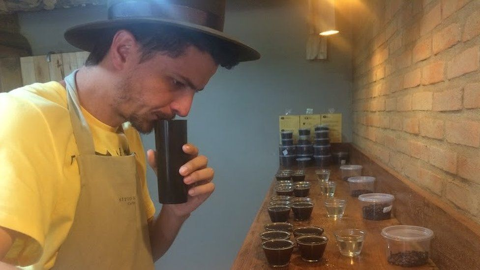Coffee farmer Jhone Lacerda tastes coffees