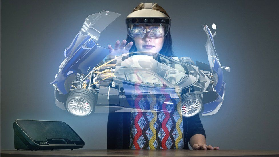 Woman manipulating virtual car