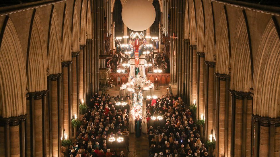 Candles are carried through Salisbury Cathedral during the advent procession