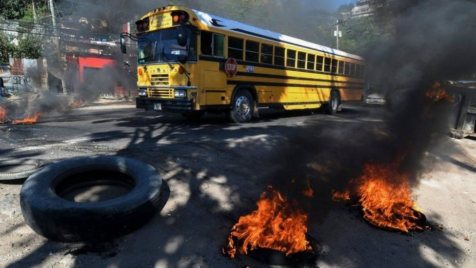 Supporters of the LIBRE opposition party mount burning roadblocks on streets and avenues during protests in Tegucigalpa on January 27, 2019. -