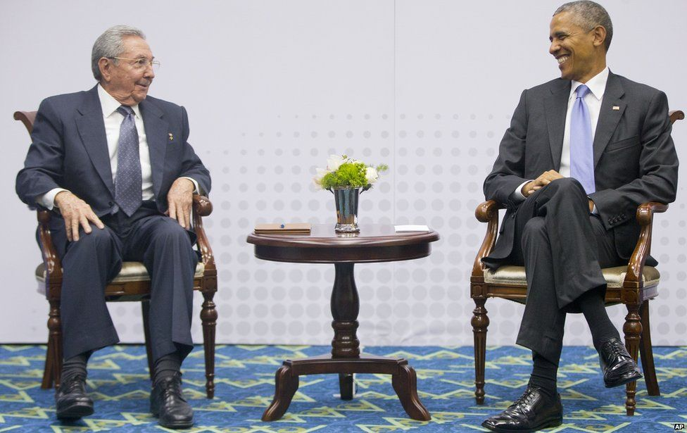 US President Barack Obama (R) smiles as he looks over towards Cuban President Raul Castro