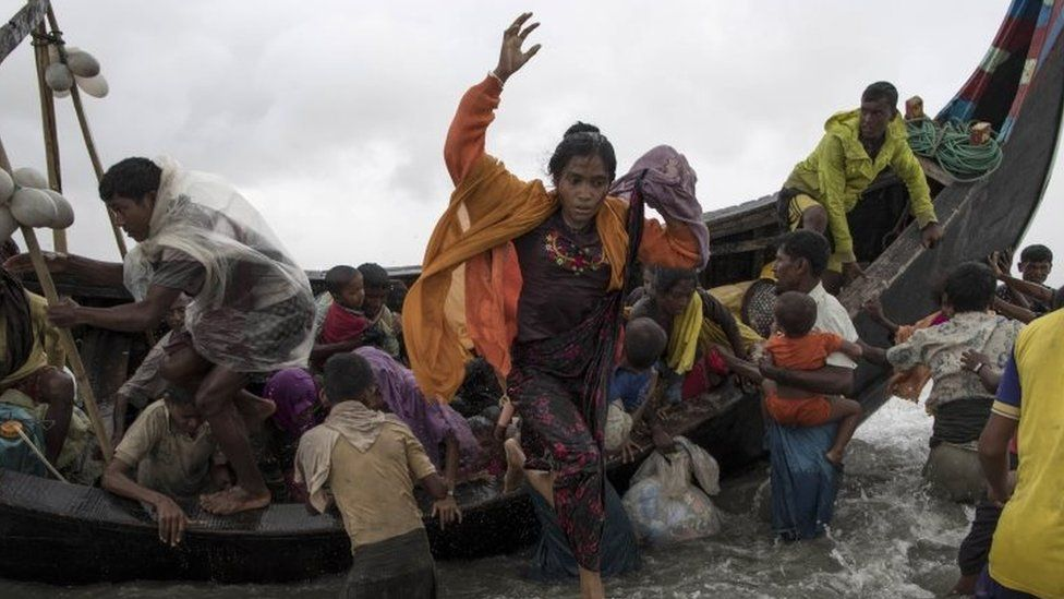 Rohingya refugees jump from a boat as it begins to tip over after travelling from Myanmar to Dakhinpara, Bangladesh (12 September 2017)
