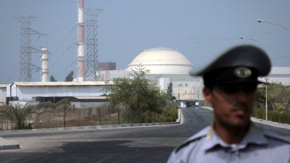 An Iranian security guard standing in front of the Bushehr nuclear power plant (2010)