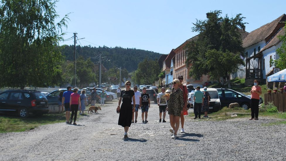 Tourists in the village of Viscri in August