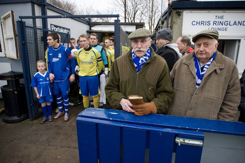 Two elderly Glossop North End supporters