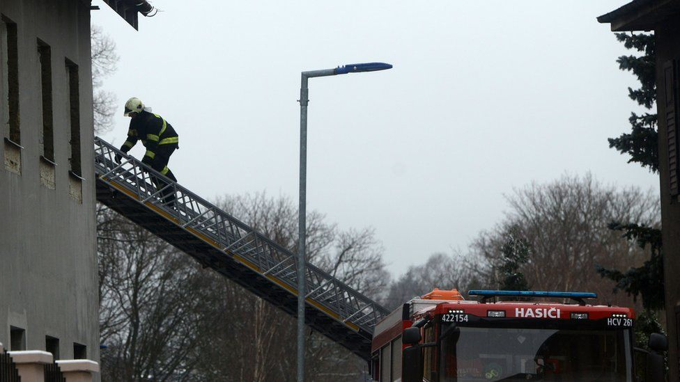 A firefighter climbs with a ladder into a home for people with learning disabilities