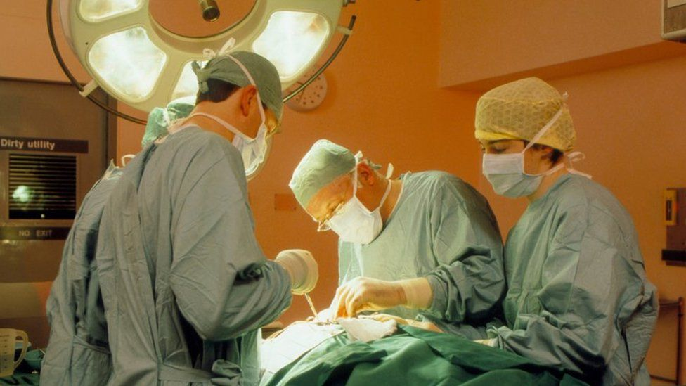 Surgeon and assistants at work during an operation