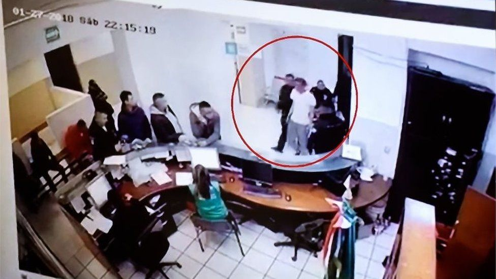 This still frame presented during a press conference in Mexico City on January 28, 2018 allegedly shows Marco Antonio Sanchez being detained in Mexico State.