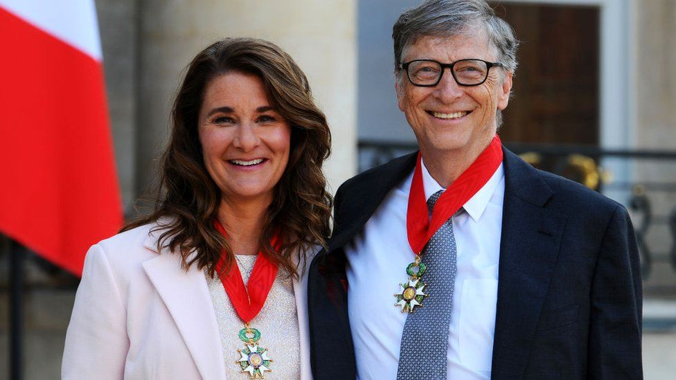 Bill and Melinda Gates pose in front of the Élysée Palace after receiving the award of Commander of the Legion of Honor by French President Francois Hollande, 21 April 2017