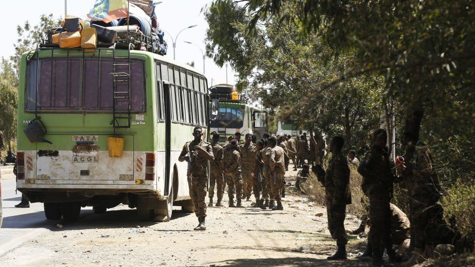 Soldiers on patrol on Mekelle on a road with buses, Ethiopia - March 2021