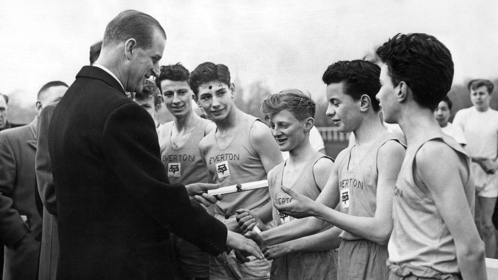 At the Liverpool Boys' Association grounds Prince Philip presents badges and certificates for the Duke of Edinburgh award in 1958