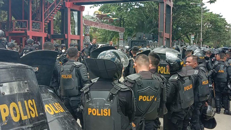 Indonesian riot police take positions at a university in provincial capital Jayapura on September 23, 2019