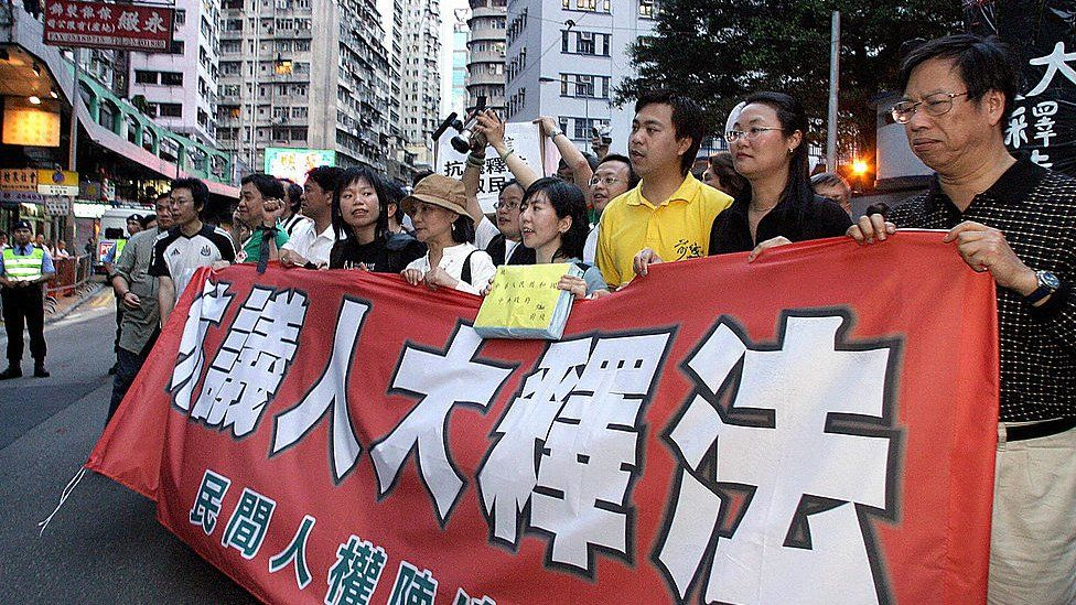 Tthousands gathered to protest against Beijing's interpretation of control over the territory's mini-constitution and for Hong Kong Chief Executive Tung Chee-hwa to step down