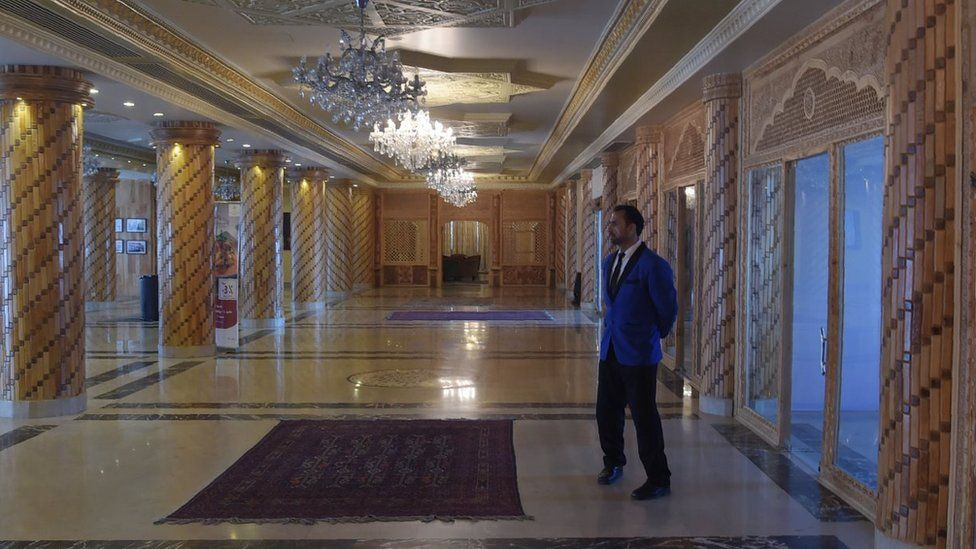 March 7, 2018 shows a bellboy standing at a hall of the Intercontinental Hotel in Kabul.
