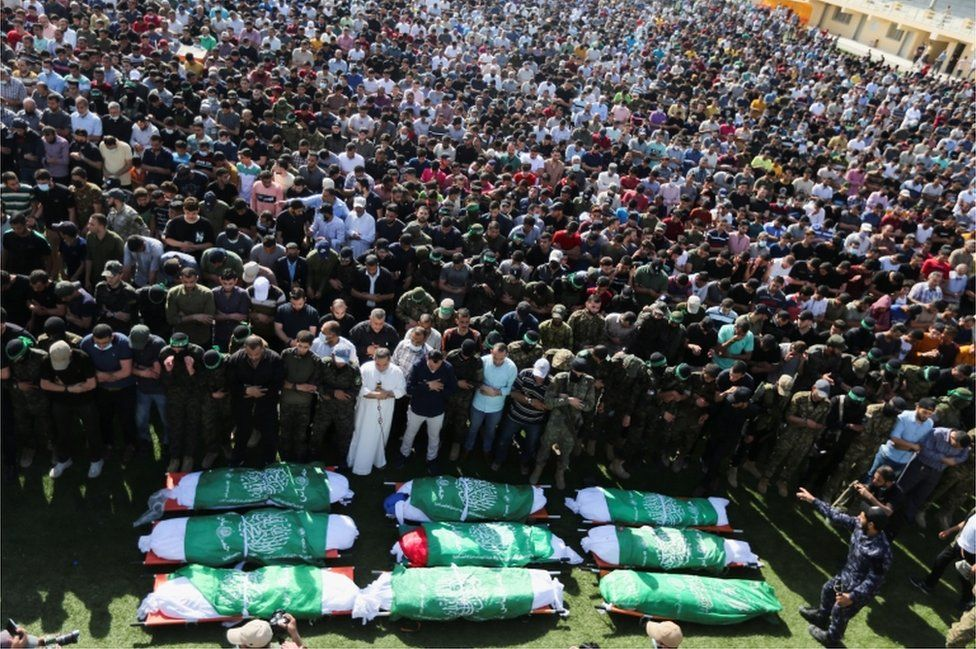 Thousands of people in Khan Younis attend a funeral for Palestinians killed during Israeli-Palestinian fighting, held on 21 May