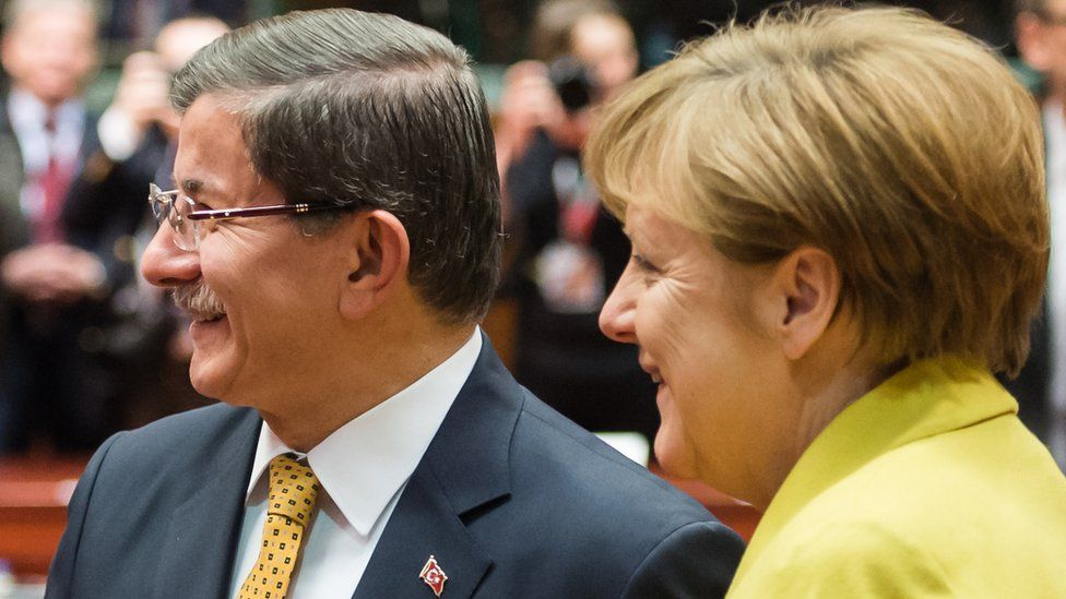 The German chancellor with Turkish PM Ahmet Davutoglu (L) on 18 March in Brussels