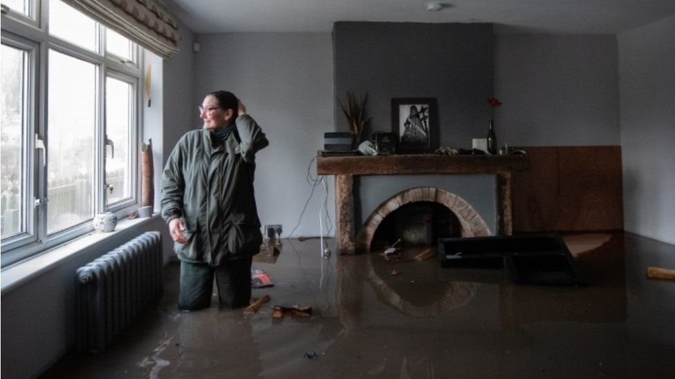 Gabrielle Burns-Smith in her flooded home