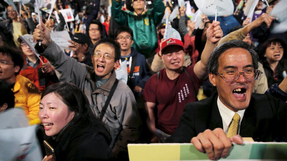 Supporters of Democratic Progressive Party (DPP) Chairperson and presidential candidate Tsai Ing-wen react to preliminary election results at party headquarters in Taipei