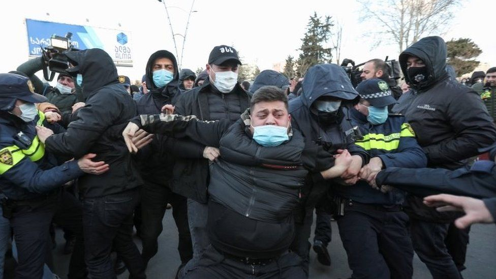 Georgian law enforcement officers detain an opposition supporter after storming the United National Movement (UNM) opposition party office in Tbilisi, Georgia on 23 February 2021