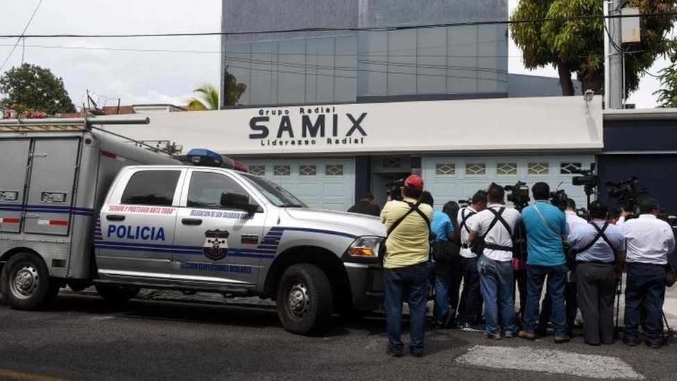Journalists surround the offices of Samix Radio Group, linked to Salvadorean former President (2004-2009) Elias Antonio Saca, as they are raided in San Salvador on November 1, 2016