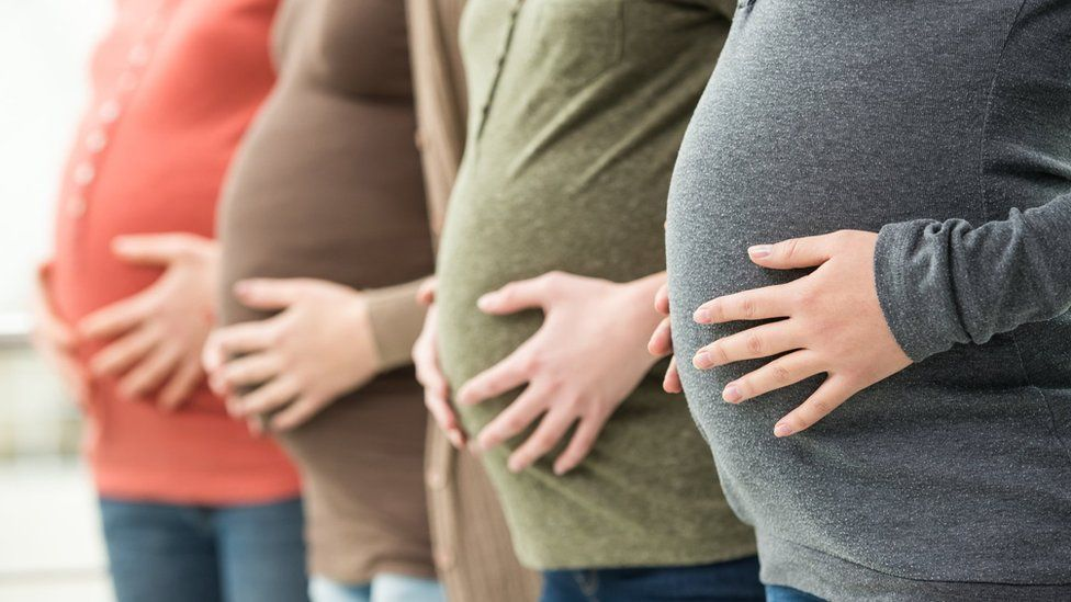 Row of pregnant women