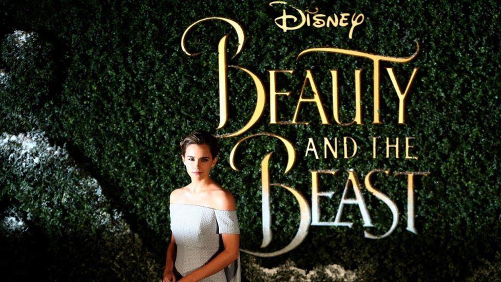 Emma Watson by Beauty and the Beast logo