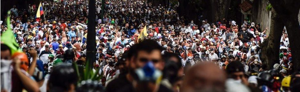 Venezuelan opposition activists march against President Nicolas Maduro, in Caracas on May 1, 2017.