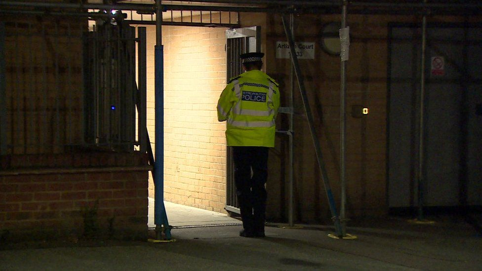 A police officer outside the building in Wood Green where the incident took place