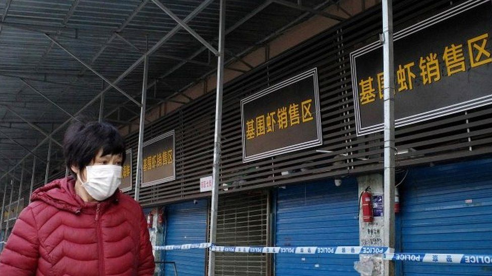 A person walks in front of a closed fish market of Wuhan, eastern China. Photo: 12 January 2020