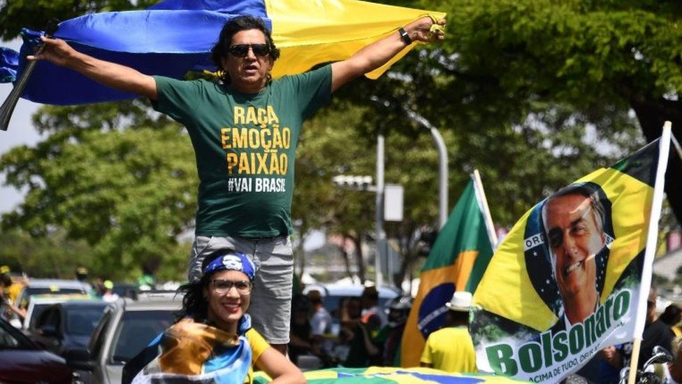 Supporters of Brazils far-right presidential candidate Jair Bolsonaro take part in a campaign rally in Brasilia, on October 6, 2018.