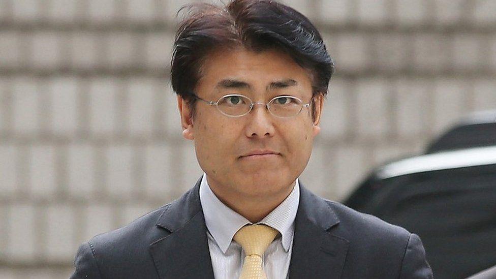 In this Oct. 19, 2015, photo, Tatsuya Kato, a former Seoul bureau chief of Japan's Sankei Shimbun, arrives at Seoul Central District Court in Seoul, South Korea.