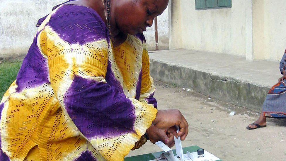 A Nigerian woman casts her vote in a 2003 election in the Niger Delta