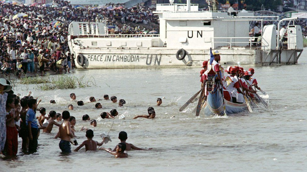 A UN warship watches over the water festival, on November 8, 1992, in Phnom Penh