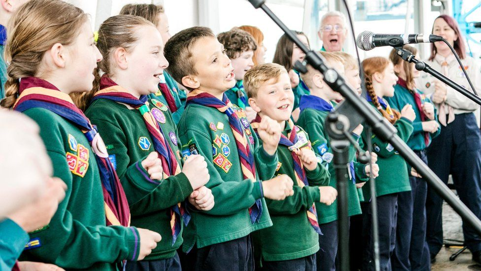 Scouts sing campfire songs