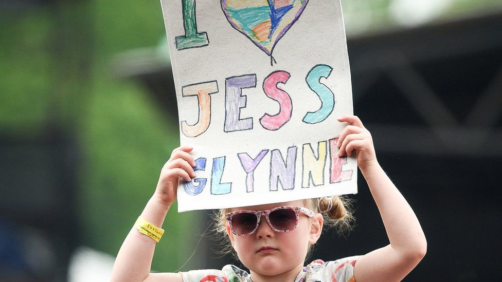 A girl holds a banner in the crowds during the first day of BBC Music's Biggest Weekend at Singleton Park, Swansea