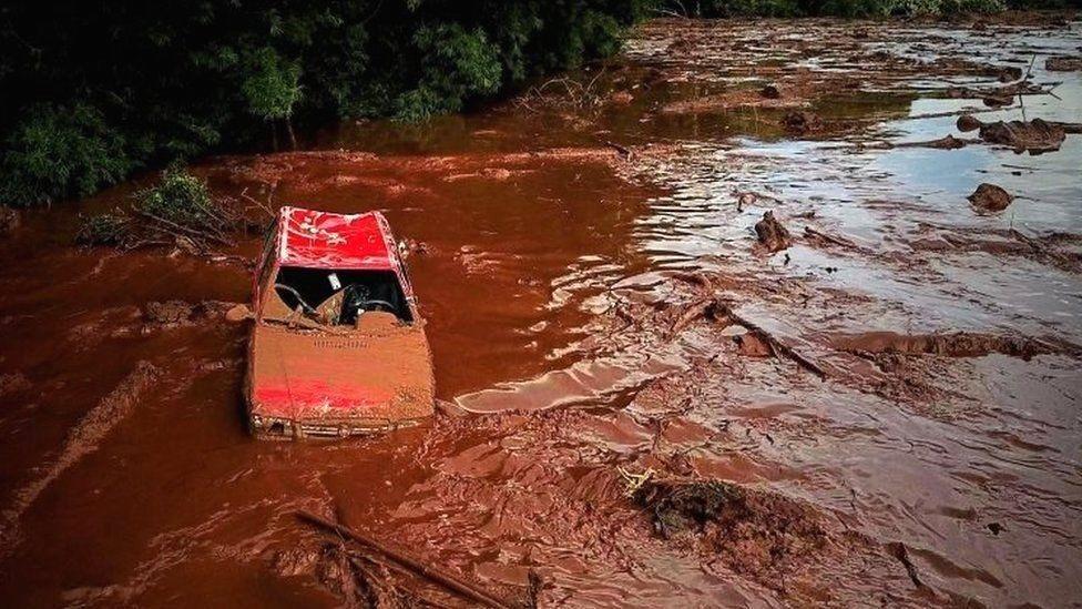 Car in middy river