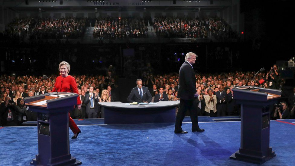 Democratic presidential nominee Hillary Clinton and Republican presidential nominee Donald Trump walk to their podiums to start the presidential debate at Hofstra University in Hempstead, N.Y., Monday, Sept. 26, 2016