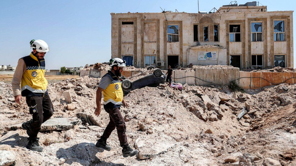 Members of the Syrian Civil Defence, also known as the White Helmets, in the western countryside of Syria's northern Aleppo province, 31 August 2019