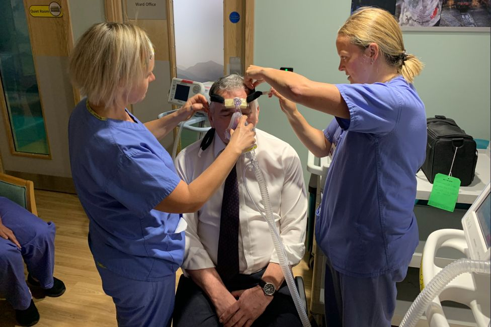 Alex Brown acting as a dummy for medical staff learning to use a CPAP ventilator