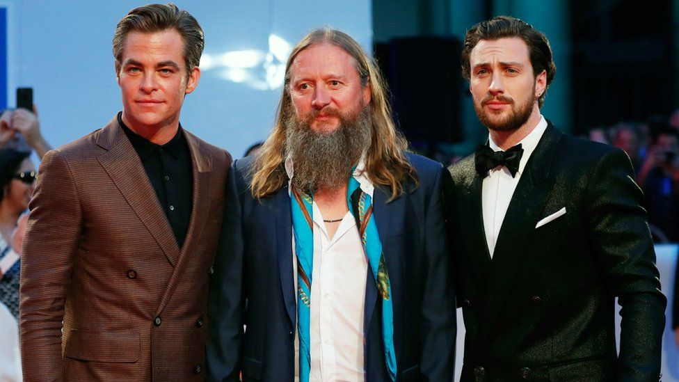 Actors Chris Pine (L) and Aaron Taylor-Johnson (R) pose with director David Mackenzie at the world premier of Outlaw King at the Toronto International Film Festival