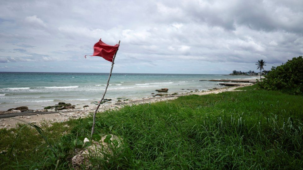 A red flag on the beach in Guanabo, Cuba