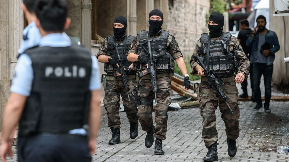 Turkish special force police officers secure area around the site of a bomb attack that targeted a police bus in Istanbul