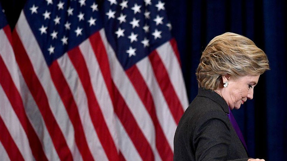 Democratic presidential candidate Hillary Clinton steps down a staircase after making a concession speech.