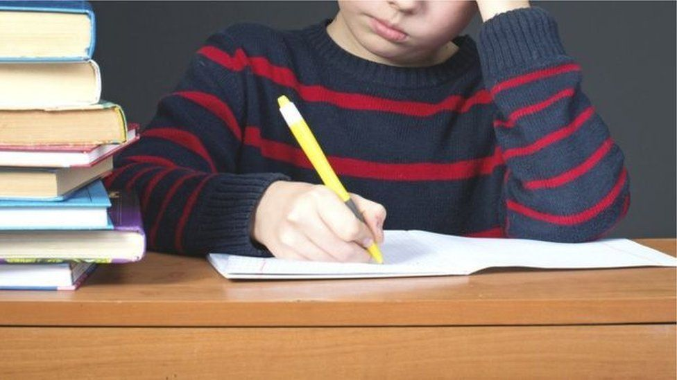 A child using a colouring pen