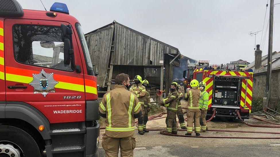 Firefighters outside burnt barn