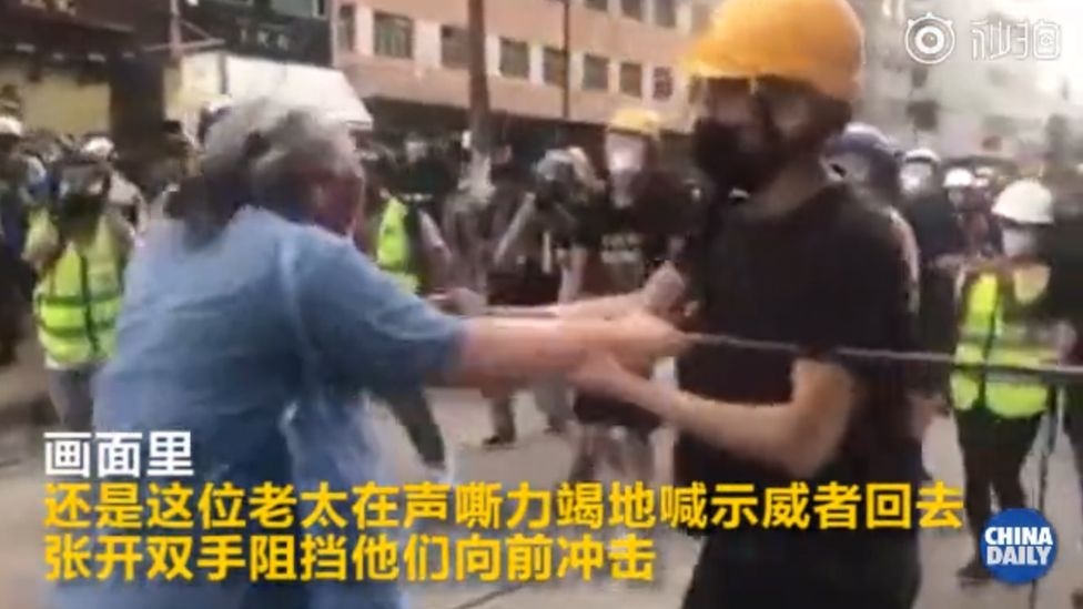 An altercation between an elderly woman and protesters