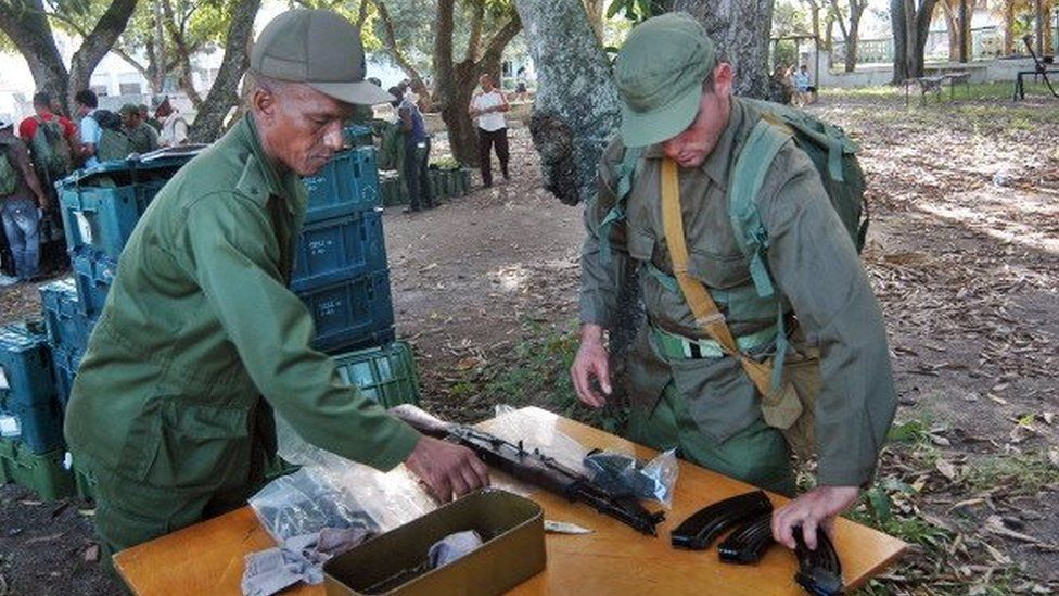 Members of an Infantry Company of the Cuban Revolutionary Armed Forces (FAR), receive weapons as part of the Bastion 2013 military exercises in Ciego de Avila province, Cuba on November 19, 2013